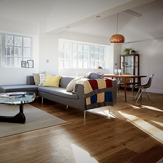 A beautiful wooden floor in a well lit stylish room
