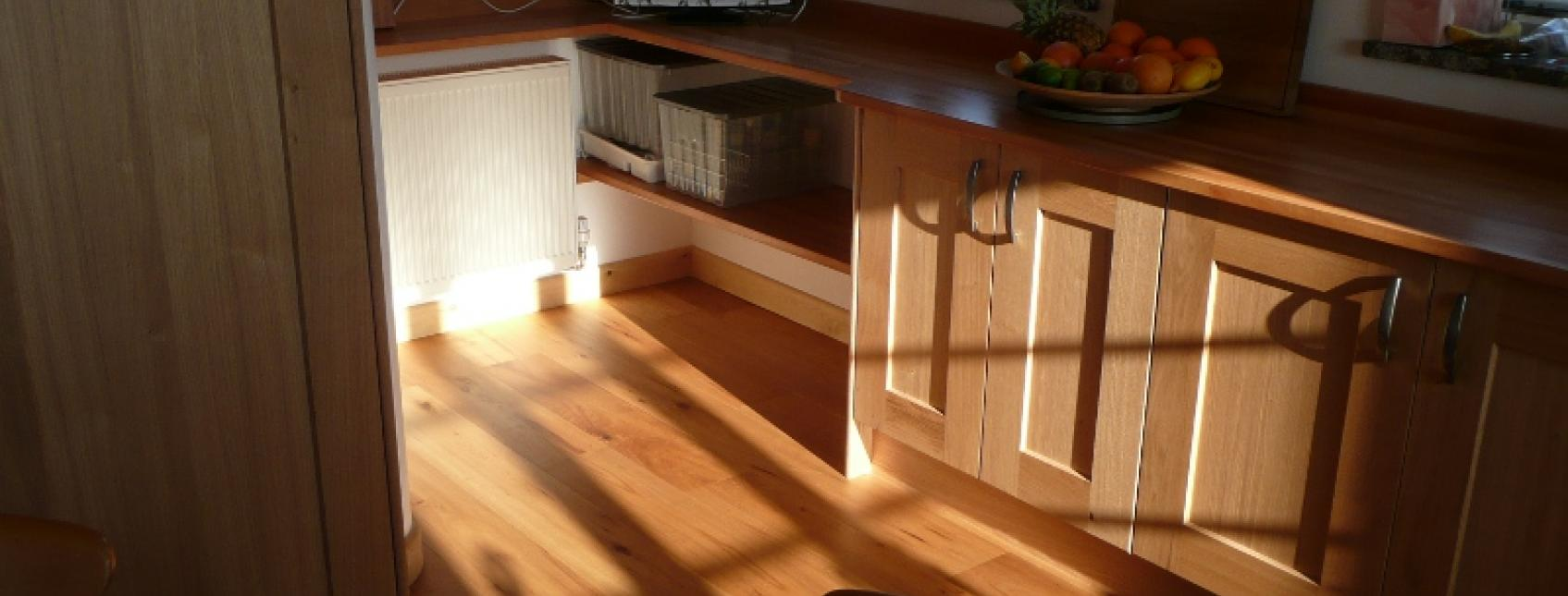 small coyttage wood flooring in kitchen
